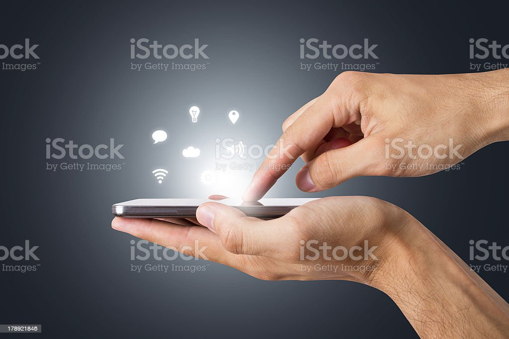 Smart Phone with Blank Screen Hand hlding and touching smart phone with blank screen with social icons, side view on dark background. Accessibility Stock Photo