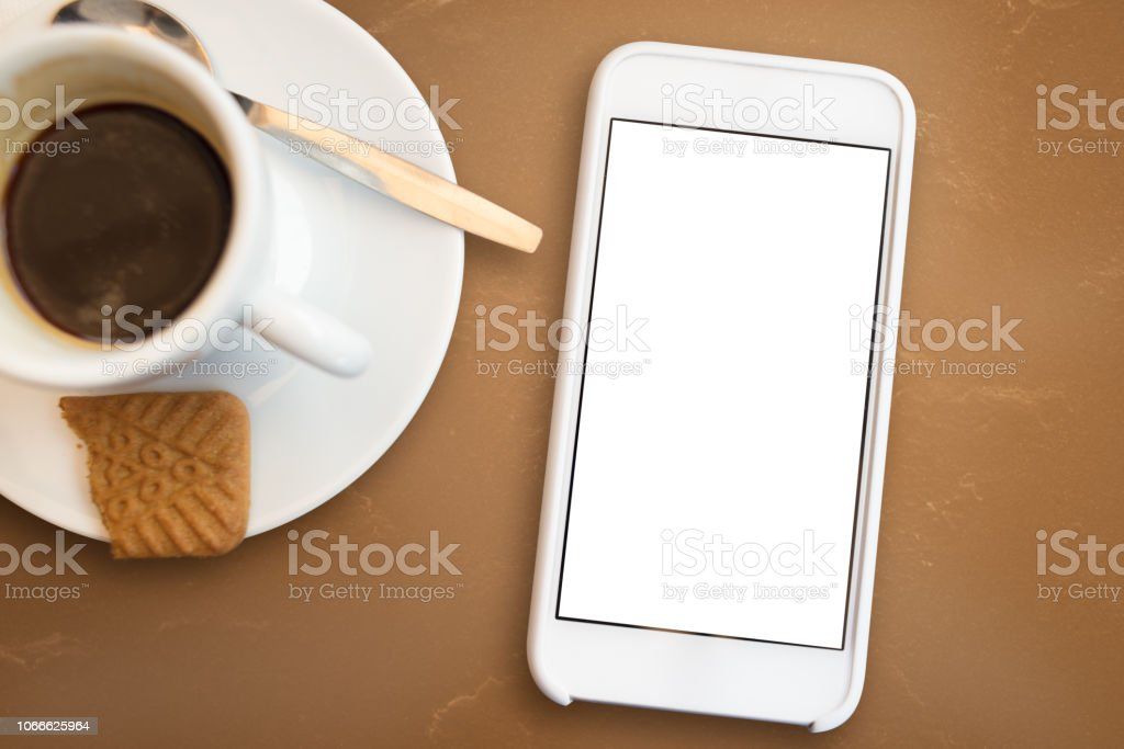 Smart Phone with Blank Screen POV with Coffee stock photo