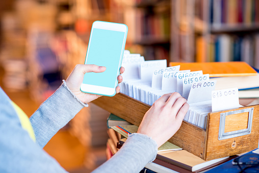 668340340 istock photo Smart phone with card catalogue 654720958