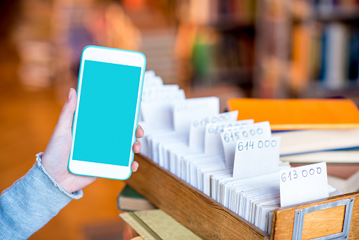 668340340 istock photo Smart phone with card catalogue 654721004