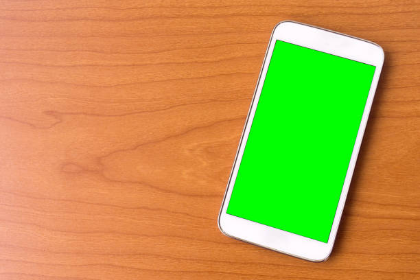 smart phone with green chroma key green screen - green screen background stock photos and pictures
