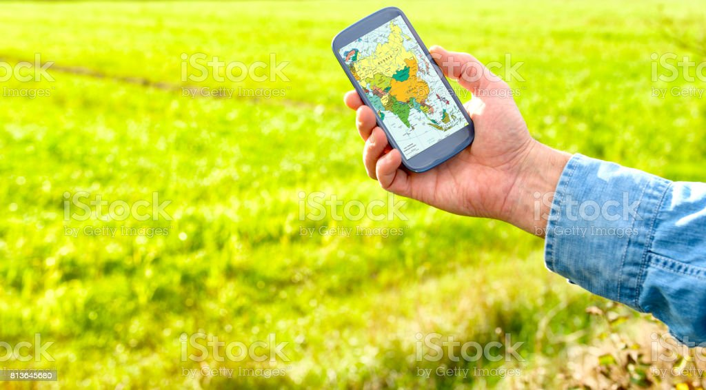 Smart phone with map of Asia stock photo