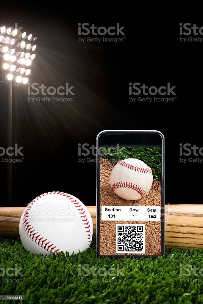 Smart Phone with online baseball tickets for a night game stock photo
