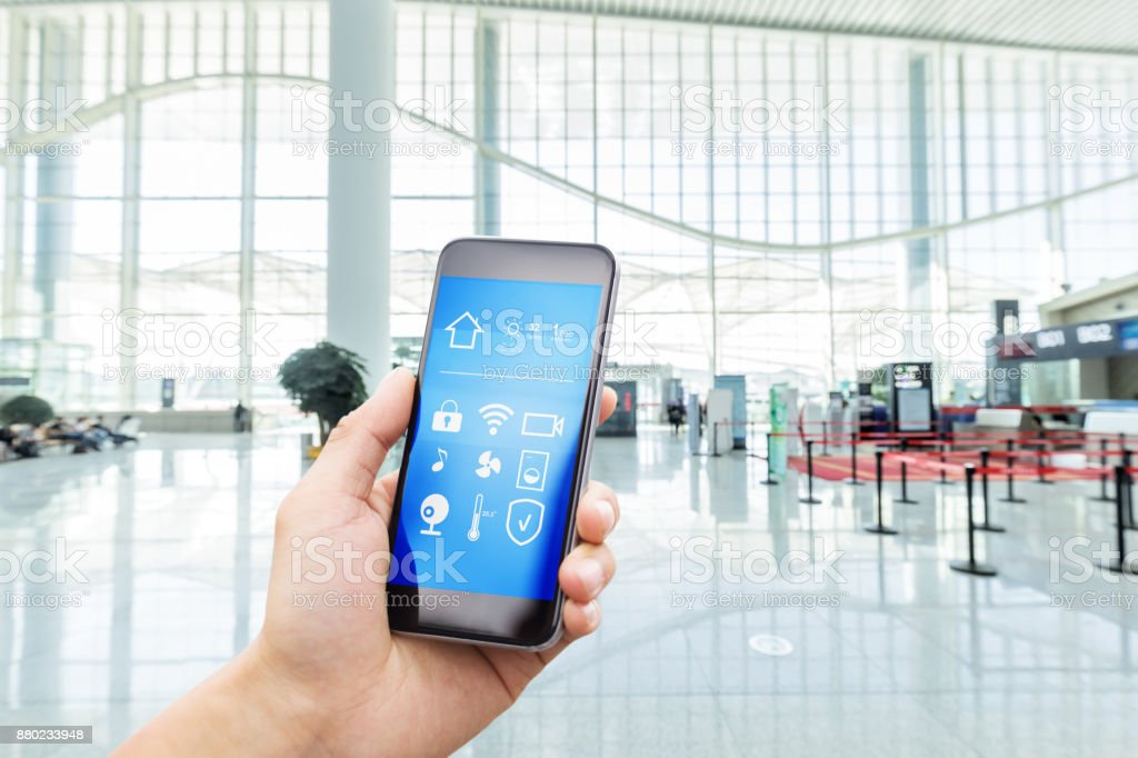 smart phone with smart home with modern hall stock photo