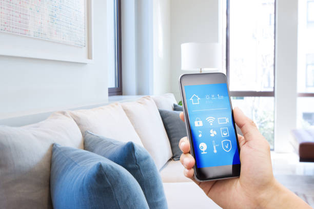 smart phone with smart home with modern living room stock photo
