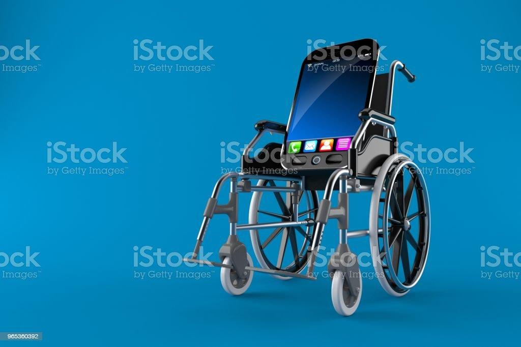 Smart phone with wheelchair zbiór zdjęć royalty-free