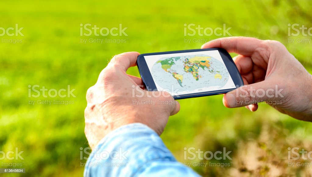 Smart phone with World Map stock photo