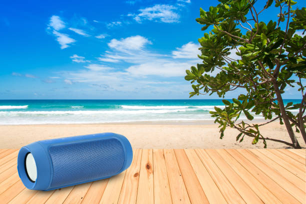 Smart phones and portable speaker on the beach. stock photo