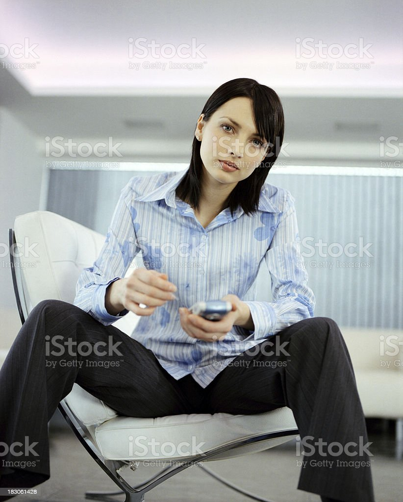 Smart Professional Businesswoman on smartphone royalty-free stock photo