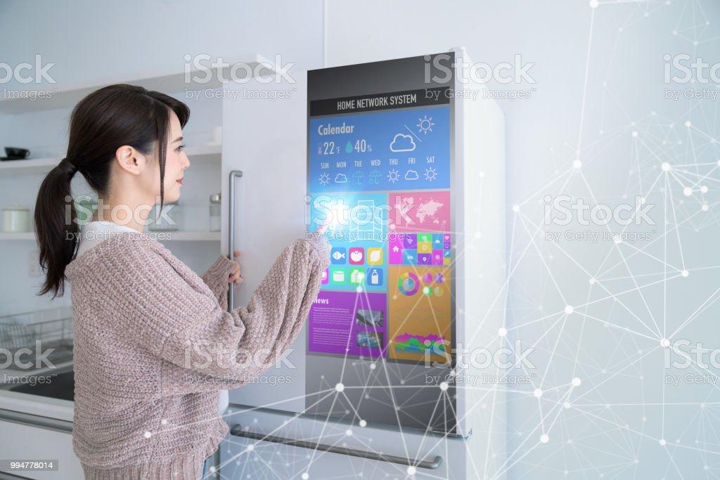 Smart refrigerator concept. Smart refrigerator concept. Home Automation Stock Photo