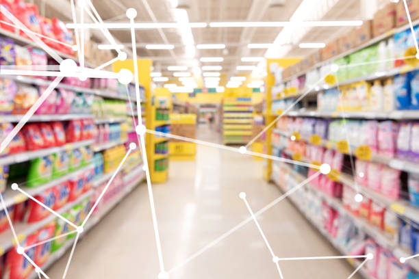 Smart retail , deep learning , neural networks technology and marketing concept. Disruption artificial intelligence atoms connect with retail shop supermarket store background. stock photo