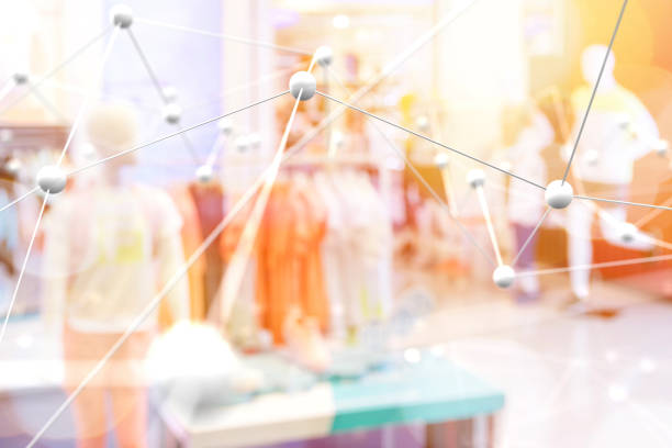 Smart retail , deep learning , neural networks technology and marketing concept. Artificial intelligence atoms connect with retail fashion shop store background. Warm tone with flare light effect. stock photo