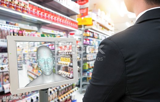 Smart retail in futuristic use iot technology concepts. Customer use facial recognition application to login to system to buy,search special price product for security reason with face payment.