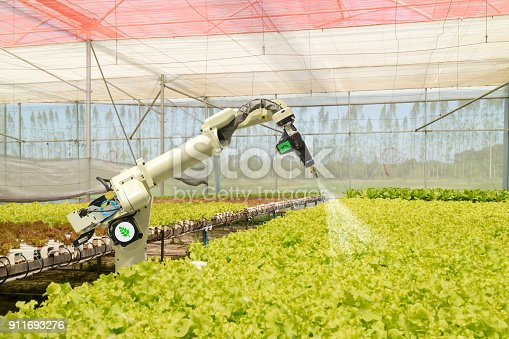 istock smart robotic in agriculture futuristic concept, robot farmers (automation) must be programmed to work to spray chemical,fertilizer or increase efficiency, growing a seed, harvesting, reduce time 911693276