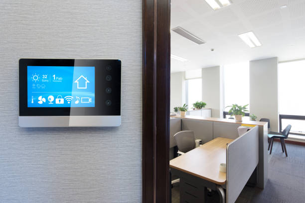 smart screen in modern office smart screen on wall in modern office smart thermostat stock pictures, royalty-free photos & images