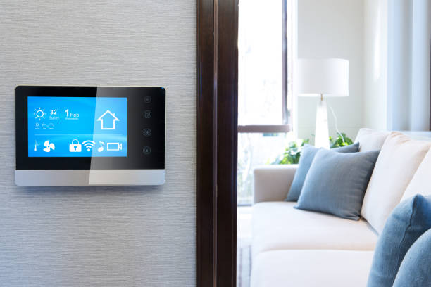 smart screen with smart home with modern living room smart screen with smart home and modern living room smart thermostat stock pictures, royalty-free photos & images