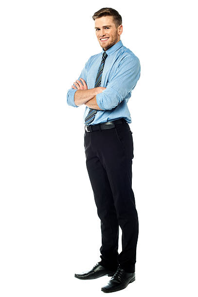 Smart smiling businessman with arms crossed stock photo