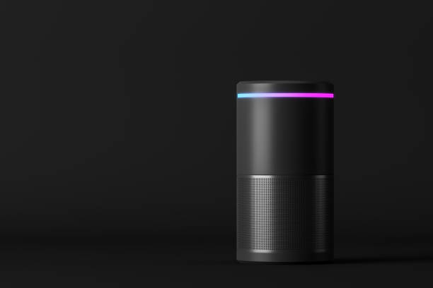 Smart speaker on black background Voice controlled smart speaker standing over black background. Concept of technology and electronics. 3d rendering mock up speech recognition stock pictures, royalty-free photos & images