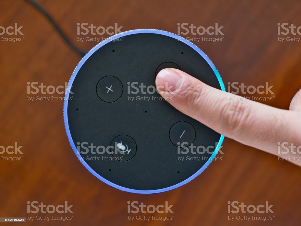 Smart speaker top view artificial intelligence assistant voice control blue ring stock photo