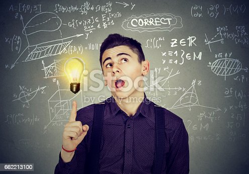 istock smart student with bright idea light bulb and high school maths and science formulas on blackboard background 662213100