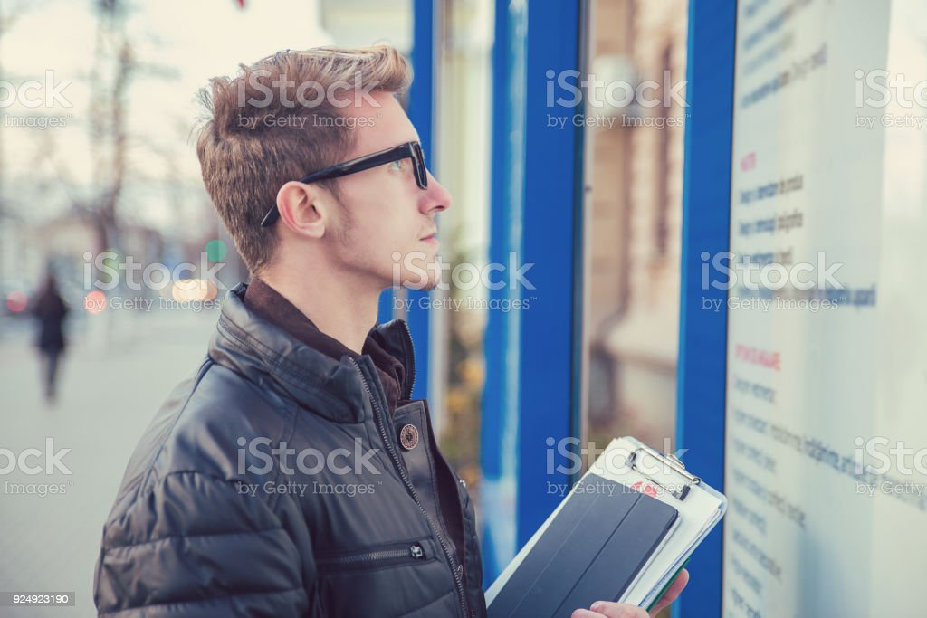 Smart student with gadget on street stock photo