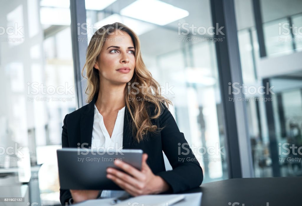 Smart tech for a smart businesswoman stock photo