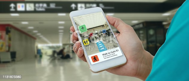 1150202730 istock photo smart technology in industry mobile 4.0 or 5.0 concept , user use mobile phone with augmented mixed virtual reality technology in real 3d for show the map,shop,  and walk way path to gate in airport 1131823380