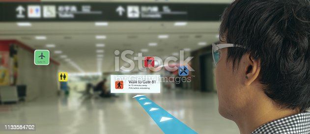 1150202730 istock photo smart technology in industry mobile 4.0 or 5.0 concept , user use smart glasses with augmented mixed virtual reality technology in real 3d for show the map,shop,  and walk way path to gate in airport 1133584702