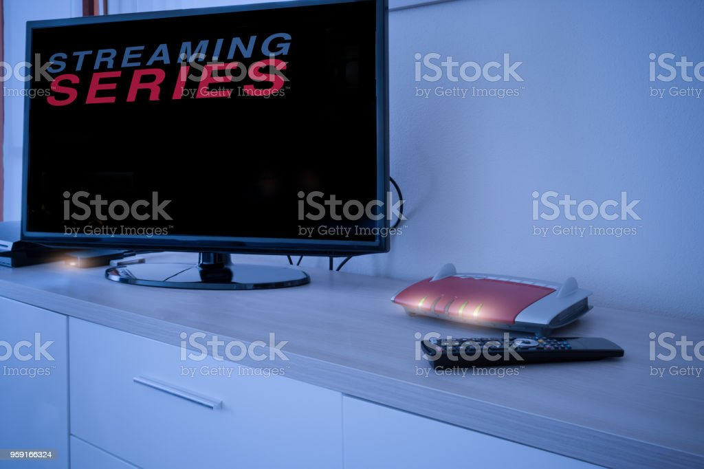 Smart tv connected to internet modem network stock photo