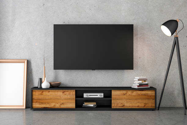 smart tv mockup hanging on the concrete with modern furniture - televisor imagens e fotografias de stock