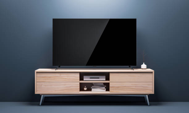 smart tv mockup with black glossy screen on console in living room - televisor imagens e fotografias de stock