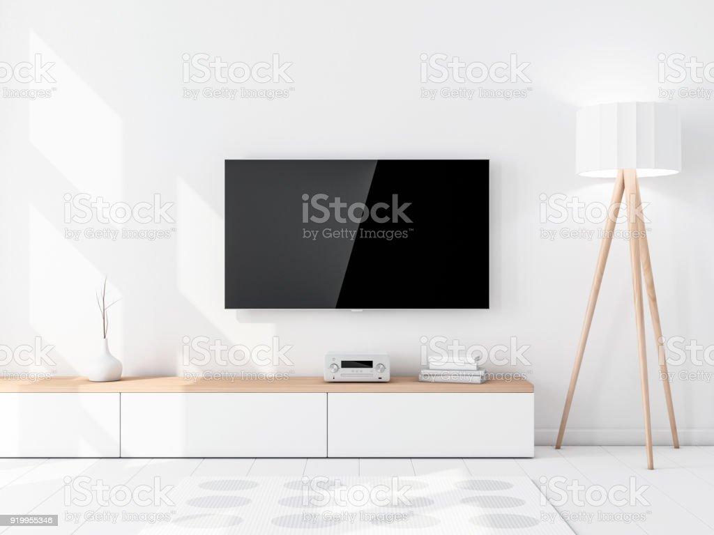 Maqueta de Tv inteligente con pantalla negra vacía colgada en la pared, moderna sala de estar con la lámpara de pie - foto de stock