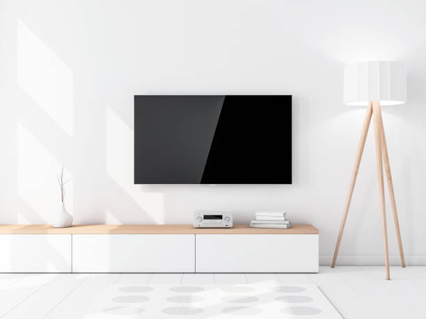 smart tv mockup with blank black screen hanging on the wall, modern living room with floor lamp - televisor imagens e fotografias de stock