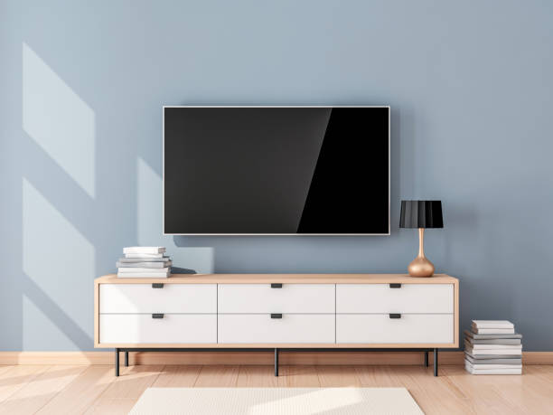 smart tv mockup with blank screen hanging on the wall in modern living room - televisor imagens e fotografias de stock