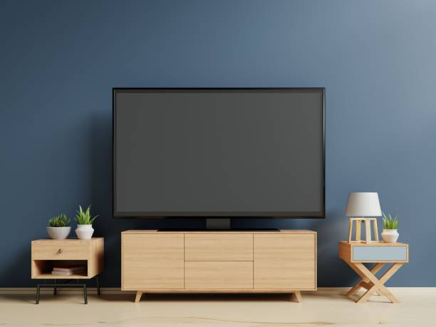 smart tv on the blue wall in living room - televisor imagens e fotografias de stock