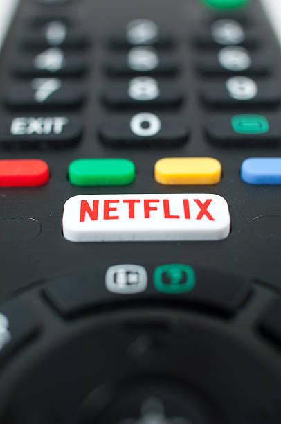 Smart TV remote control with Netflix button. Zagreb, Croatia - March 5, 2016: Smart TV remote control with Netflix button. netflix stock pictures, royalty-free photos & images