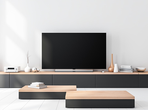 Smart Tv set Mockup standing on wooden console