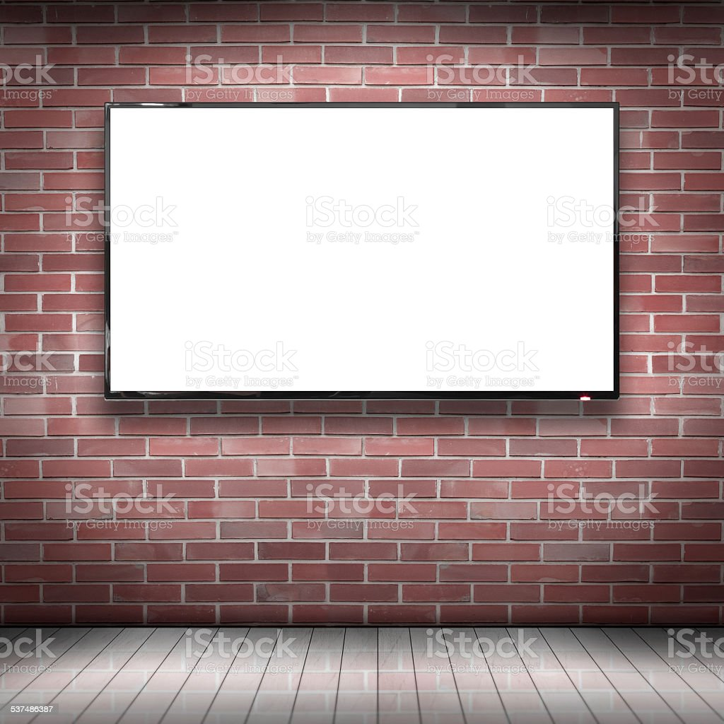 Smart tv with blank screen hung on the brick wall stock photo