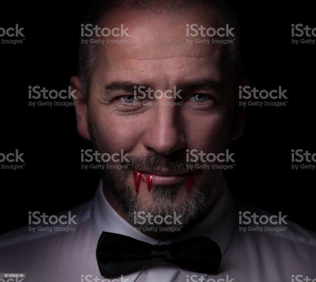 Smart Vampire with blood stock photo