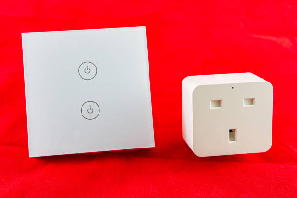 Smart Wi-Fi switch with support for control via mobile  phone application stock photo