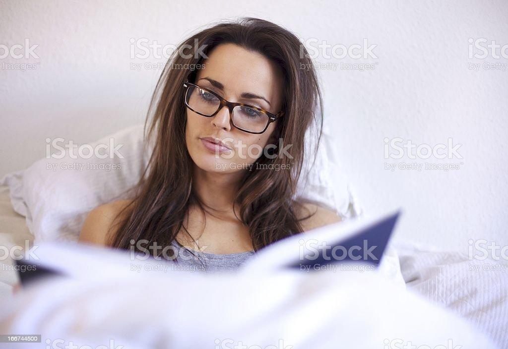 Smart Woman Enjoying Reading a Book royalty-free stock photo