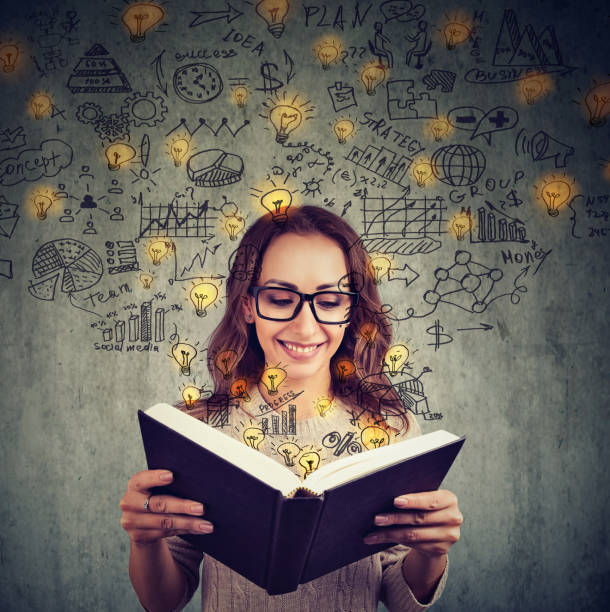 smart woman reading book - genius stock photos and pictures