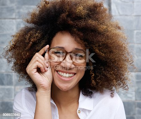 istock Smart young african woman with glasses 506922640
