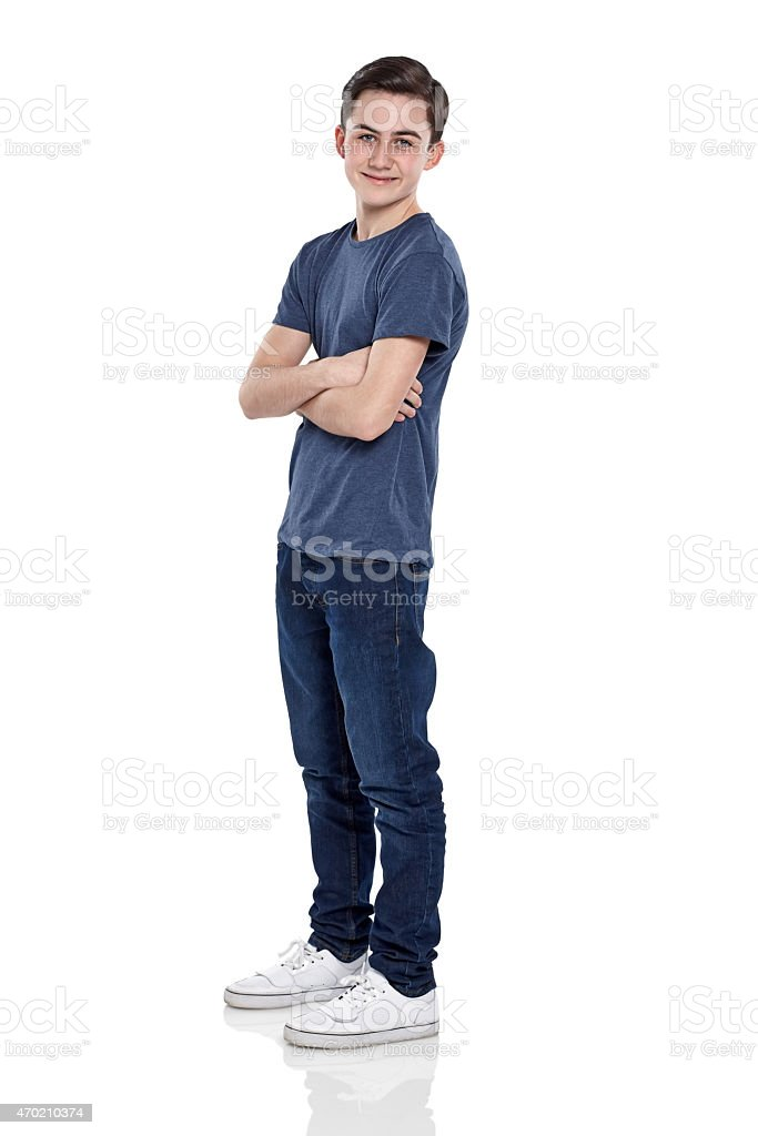 Smart young boy posing for camera stock photo