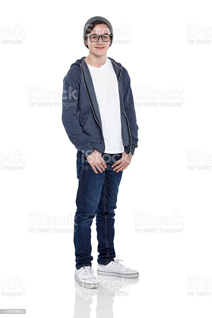 Smart young boy wearing glasses and cap posing on white​​​ foto