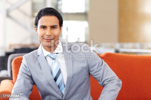 530281723istockphoto Smart Young Businessman Smiling 171378384