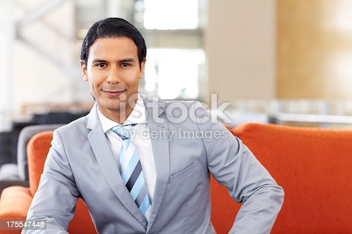 530281723istockphoto Smart Young Businessman Smiling 175547448