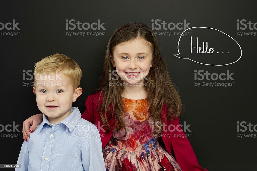 Smart young children infront of a blackboard stock photo