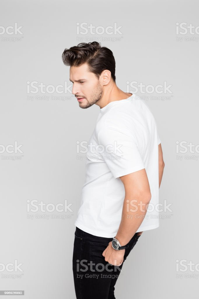 Smart young guy posing on grey background Portrait of smart young guy posing on grey background 25-29 Years Stock Photo