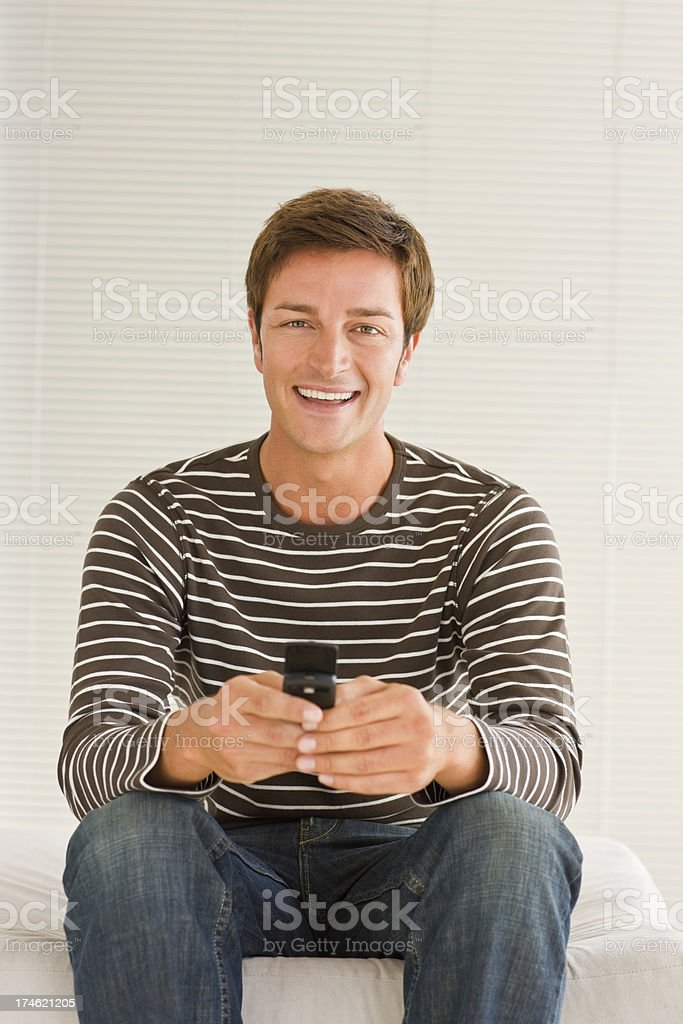 Smart young male using cellphone over white background royalty-free stock photo